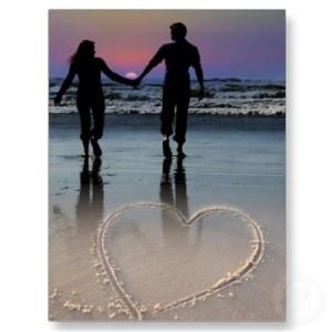 lovers_holding_hands_walking_beach_sunset